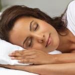 Brunette woman sleeping happily