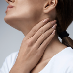Woman with sore throat or swollen glands