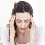 Woman with depression and a migraine headache